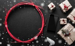 Xmas background with gifts and mobile phone space and space for christmas message for those close to bakgraund. Stock Image