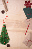 Xmas background with handmade fir tree, red stars and envelope. Top view, copy space. Stock Photos