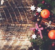 Xmas background with tangerines, cinnamon sticks, gingerbread cookies. Xmas background with tangerines, cinnamon sticks, gingerbread cookie stars and fir tree Stock Images