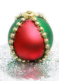 Xmas ball. Red, green and gold Christmas ornament Stock Image