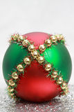 Xmas ball. Red, green and gold Christmas ornament Stock Images