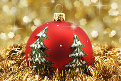 Xmas ball on gold background Royalty Free Stock Photography
