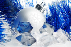 Xmas ball and ice cubes Stock Photo