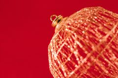 Xmas ball over red Royalty Free Stock Photos