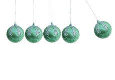 Xmas ball pendulum Royalty Free Stock Image
