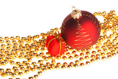 Xmas ball and present box lying on yellow beads Royalty Free Stock Images