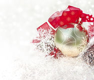 Xmas ball, red ribbon on abstract xmas background Stock Images