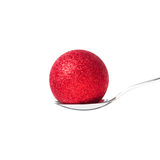 Xmas ball in the spoon. Red xmas ball in the spoon Royalty Free Stock Images