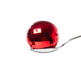 Xmas ball in the spoon. Red xmas ball in the spoon - isolated Royalty Free Stock Image