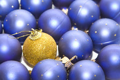 Xmas Balls. Dark blue New Year's spheres and one yellow Royalty Free Stock Photo