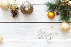 Xmas balls hearts on Christmas tree, happy new year card decoration on white wooden background, top view, copy space Royalty Free Stock Photo