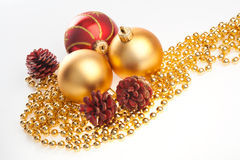 Xmas balls and cones on golden beads Royalty Free Stock Image