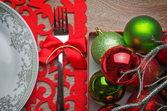 Xmas balls on decorated table Royalty Free Stock Photography