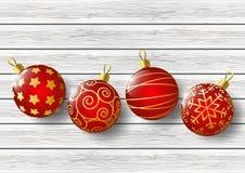 Xmas balls on light wood Royalty Free Stock Photos