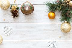 Xmas balls on merry Christmas tree, happy new year card decoration on white wooden background, top view, copy space Royalty Free Stock Images