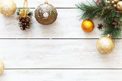 Xmas balls on merry Christmas tree, happy new year card decoration on white wooden background, top view, copy space Stock Images