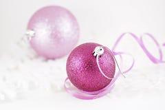 Xmas balls with ribbons. Christmas balls with ribbons on big white snowflakes Royalty Free Stock Photos