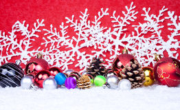 Xmas balls in snow Stock Photography