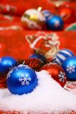 Xmas balls in snow Royalty Free Stock Image