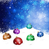 Xmas Balls on Snow Hill Stock Photos