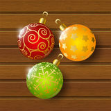 Xmas balls on wood Royalty Free Stock Images