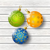 Xmas balls on wood Stock Images