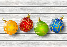Xmas balls on wood Royalty Free Stock Photo