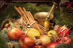 Xmas basket with apple, vlanuts, needles and mortar Stock Photography