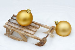Xmas bauble on toboggan Royalty Free Stock Photography