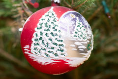 Xmas bauble on tree Royalty Free Stock Image