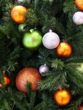 Xmas Baubles. Bright baubles on a Christmas tree Royalty Free Stock Image