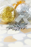 Xmas baubles on paper with hearts Royalty Free Stock Image
