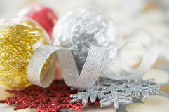 Xmas baubles on paper with hearts Royalty Free Stock Photos