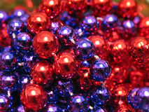 Xmas Beads. Red and purple beads stock photography