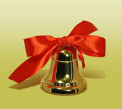 Xmas bell. Xmas golden bell with red bow stock image