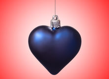 Xmas big blue heart on red background Royalty Free Stock Photography