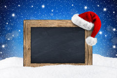 XMAS blackboard in snow Stock Photography