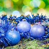 Xmas blue balls on blurred green background Stock Images