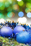 Xmas blue decoration on blurred green background Stock Images