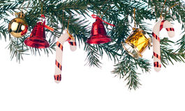 Xmas border. Xmas tree with bell, ball, drum and lollipops Stock Images