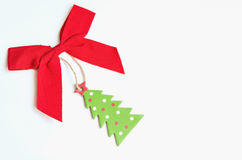 Xmas bow and christmas tree Stock Photo