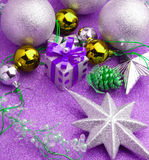 Xmas box gift with silver ball around with purple background stock images