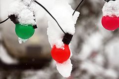 Xmas bulbs. Under the snow in a cold winter royalty free stock image