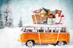 The Xmas bus in winter season. With many snowflakes driving in snowy landscape. For christmas invitation Royalty Free Stock Image