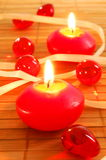 Xmas candle. Romantic red xmas candles showing christmas decoration royalty free stock photo
