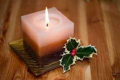 Xmas candle. With evergreen ilex Stock Images