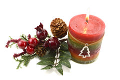 Xmas candle with decorations. Christmas candle with decorated branch isolated Royalty Free Stock Images