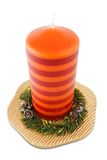 Xmas candle on plate Royalty Free Stock Photography