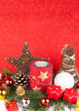 Xmas candles as xmas card. Red and white christmas candles in snow - xmas card Stock Images