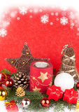 Xmas candles as xmas card. Red and white christmas candles in snow - xmas card Stock Photo